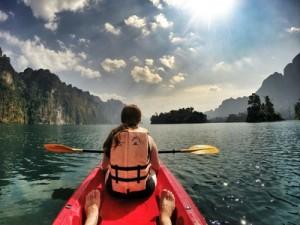 Kayaking on lake with friend